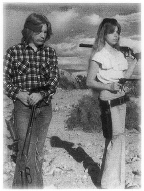 [Teenagers Arthur and Doreen with rifles]